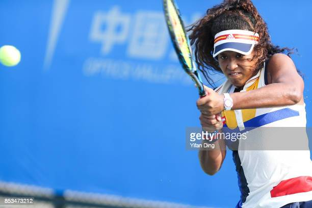 Naomi Osaka of Japan plays a backhand during the match against Elise Mertens of Belgium on Day 2 of 2017 Dongfeng Motor Wuhan Open at Optics Valley...