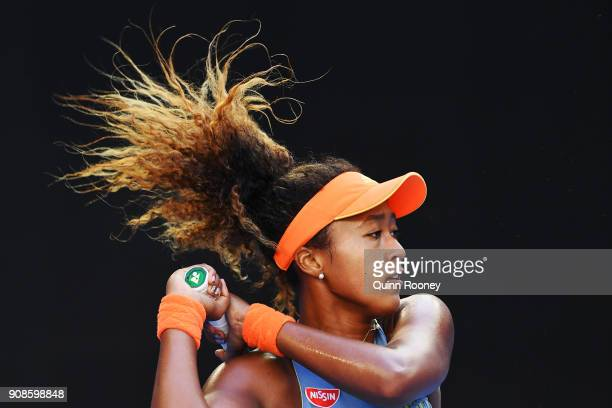 Naomi Osaka of Japan plays a backhand in her fourth round match against Simona Halep of Romania on day eight of the 2018 Australian Open at Melbourne...