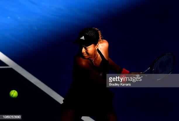 Naomi Osaka of Japan plays a backhand in her match against Anastasija Sevastova of Latvia during day five of the 2019 Brisbane International at Pat...