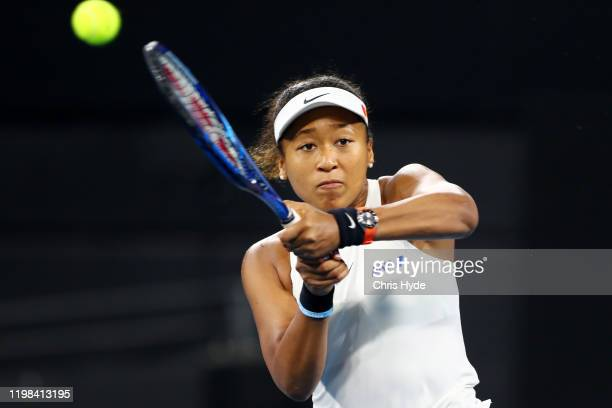 Naomi Osaka of Japan plays a backhand in her match against Sofia Kenin of the United States during day four of the 2020 Brisbane International at Pat...