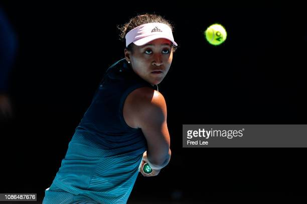 Naomi Osaka of Japan plays a backhand in her quarter final match against Elina Svitolina of Ukraine during day 10 of the 2019 Australian Open at...