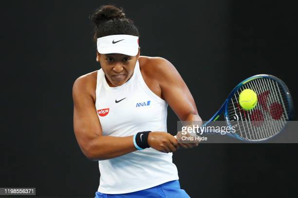Naomi Osaka of Japan plays a backhand in her quarter final match against Kiki Bertens of the Netherlands during day five of the 2020 Brisbane...