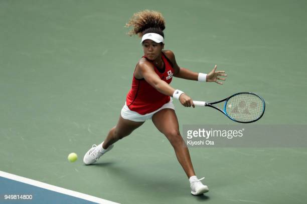 Naomi Osaka of Japan plays a backhand in her singles match against Johanna Konta of Great Britain during day two of the Fed Cup World Group II...