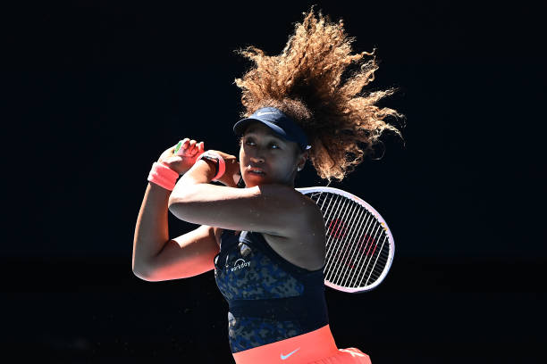 Naomi Osaka of Japan plays a backhand in her Women's Singles Semifinals match against Serena Williams of the United States during day 11 of the 2021...