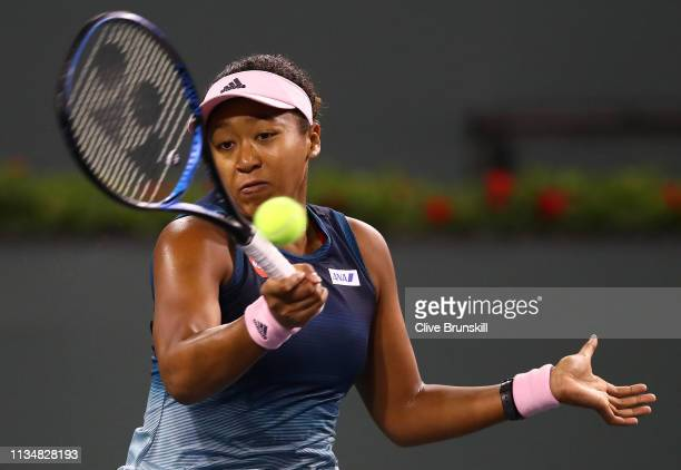 Naomi Osaka of Japan plays a forehand against Kristina Mladenovic of France during their women's singles second round match on day six of the BNP...