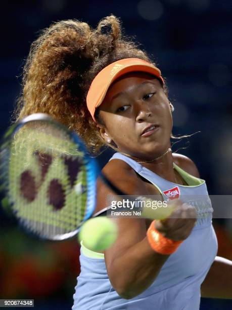 Naomi Osaka of Japan plays a forehand against Kristina Mladenovic of France during day one of the WTA Dubai Duty Free Tennis Championship at the...