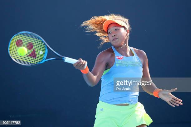 Naomi Osaka of Japan plays a forehand in her first round match against Kristina Kucova of Slovakia on day two of the 2018 Australian Open at...