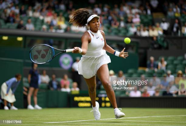 Naomi Osaka of Japan plays a forehand in her Ladies' Singles first round match against Yulia Putintseva of Kazakhstan during Day one of The...