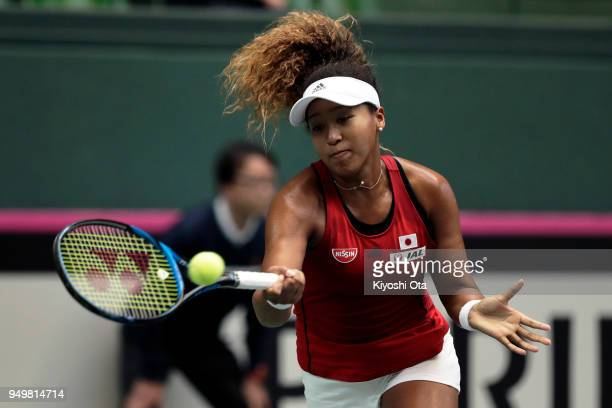 Naomi Osaka of Japan plays a forehand in her singles match against Johanna Konta of Great Britain during day two of the Fed Cup World Group II...