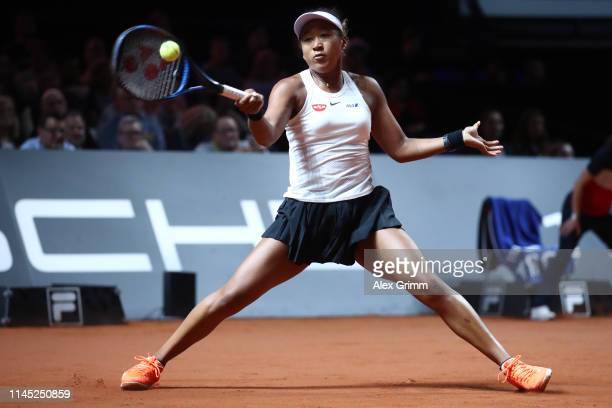 Naomi Osaka of Japan plays a forehand to Donna Vekic of Croatia during their quarterfinal on day 5 of the Porsche Tennis Grand Prix at PorscheArena...