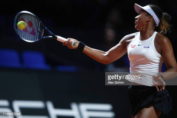 Naomi Osaka of Japan plays a forehand to SuWei Hsieh of Taiwan during their round of 16 match on day 4 of the Porsche Tennis Grand Prix at...