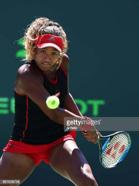 Naomi Osaka of Japan plays a shot against Elina Svitolina of the Ukraine during Day 5 of the Miami Open at the Crandon Park Tennis Center on March 23...