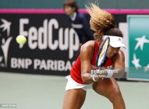 Naomi Osaka of Japan plays in a 63 63 defeat to Johanna Konta of Britain at a Fed Cup World Cup Group 2 playoff in Miki Hyogo Prefecture on April 22...