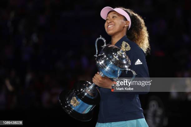 Naomi Osaka of Japan poses for a photo with the Daphne Akhurst Memorial Cup following victory in her Women's Singles Final match against Petra...