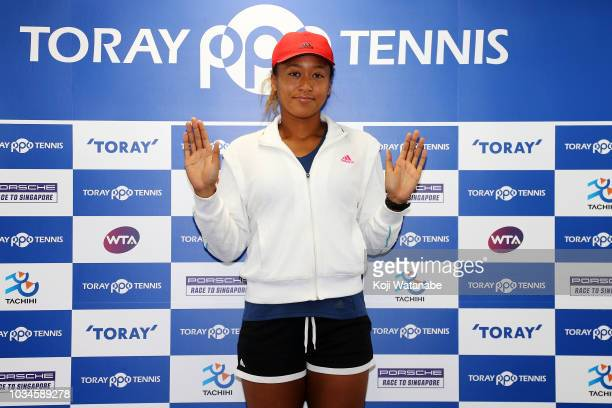 Naomi Osaka of Japan poses for photographs during a press conference on day one of the Toray Pan Pacific Open at Arena Tachikawa Tachihi on September...