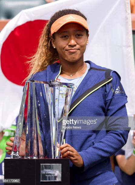 Naomi Osaka of Japan poses with the BNP Paribas Open championship trophy after defeating Daria Kasatkina of Russia in the women's singles final in...