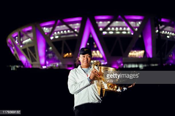 Naomi Osaka of Japan poses with the champion trophy after the Women's Singles final match against Ashleigh Barty of Australia on Day nine of 2019...