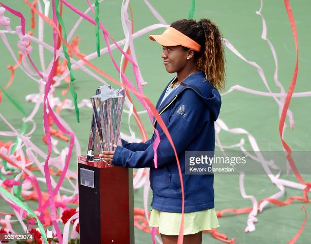 Naomi Osaka of Japan poses with the championship trophy after defeating Daria Kasatkina of Russia during the women's final on Day 14 of BNP Paribas...