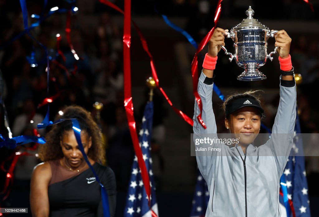 Naomi Osaka of Japan poses with the championship trophy after winning the Women's Singles finals match against Serena Williams of the United States on Day Thirteen of the 2018 US Open at the USTA Billie Jean King National Tennis Center on September 8, 2018 in the Flushing neighborhood of the Queens borough of New York City.