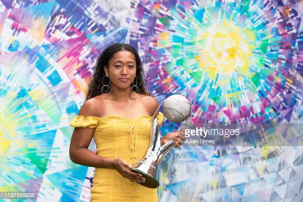 Naomi Osaka of Japan poses with the Chris Evert WTA World No1 trophy during day three of the Miami Open tennis on March 20 2019 in Miami Gardens...
