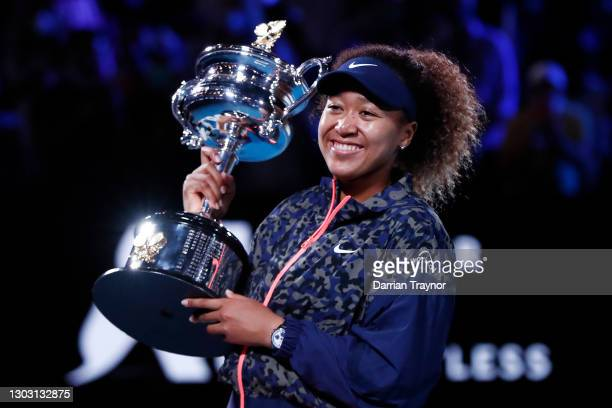Naomi Osaka of Japan poses with the Daphne Akhurst Memorial Cup after winning her Women's Singles Final match against Jennifer Brady of the United...