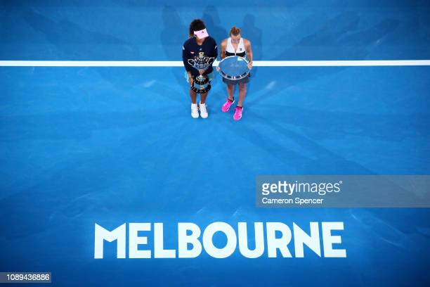 Naomi Osaka of Japan poses with the Daphne Akhurst Memorial Cup, and Petra Kvitova of Czech Republic poses with the runners-up trophy following the...
