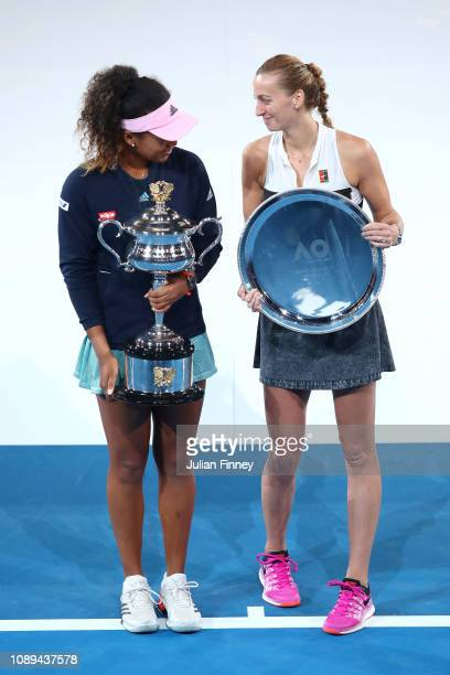 Naomi Osaka of Japan poses with the Daphne Akhurst Memorial Cup following Petra Kvitova of the Czech Republic with the runners-up trophy following...