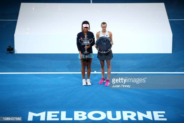 Naomi Osaka of Japan poses with the Daphne Akhurst Memorial Cup following Petra Kvitova of the Czech Republic with the runnersup trophy following the...