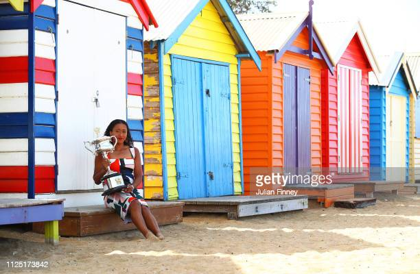 Naomi Osaka of Japan poses with the Daphne Akhurst Memorial Cup during the Women's Australian Open media opportunity at Brighton Beach on January 27,...