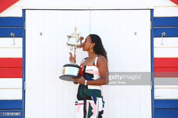 Naomi Osaka of Japan poses with the Daphne Akhurst Memorial Cup during the Women's Australian Open media opportunity at Brighton Beach on January 27...