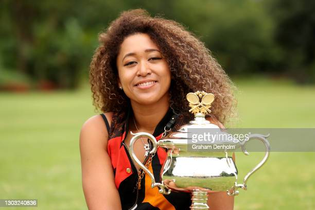 Naomi Osaka of Japan poses with the Daphne Akhurst Memorial Trophy after winning the 2021 Australian Open Women's Final, at Government House on...