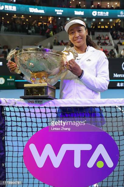 Naomi Osaka of Japan poses with the trophy during the medal ceremony after the Women's singles final match against Ashleigh Barty of Australia on day...