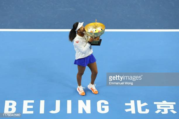 Naomi Osaka of Japan poses with the trophy during the medal ceremony after the Women's singles final match against Ashleigh Barty of Australia at the...