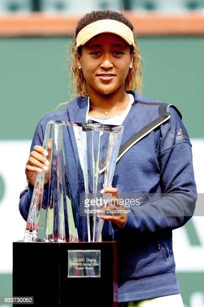Naomi Osaka of Japan poses with the winner's trophy after defeating Daria Kasatkina of Russia during the women's final on Day 14 of the BNP Paribas...