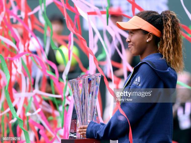 Naomi Osaka of Japan poses withe the trophy after her victory in the WTA final over Daria Kasatkina of Russia with her coach Sascha Bajin during the...