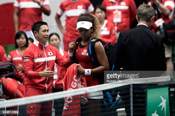 Naomi Osaka of Japan prepares to leave the court after losing her singles match against Johanna Konta of Great Britain during day two of the Fed Cup...