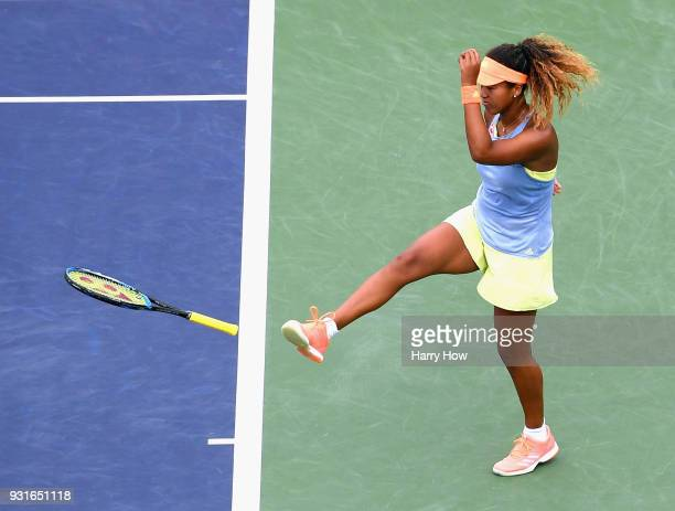 Naomi Osaka of Japan reacts after a lost point in her match against Maria Sakkari of Greece during the BNP Paribas Open at the Indian Wells Tennis...