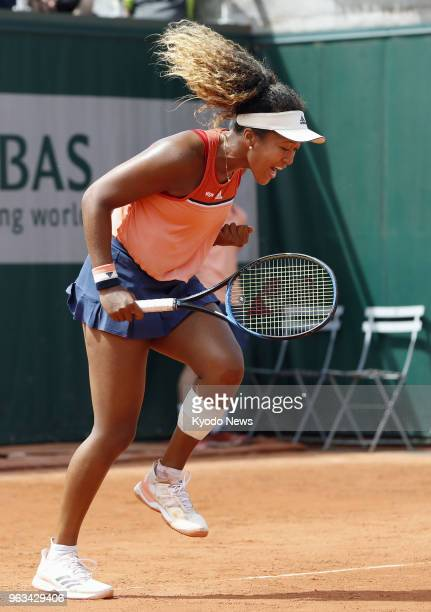Naomi Osaka of Japan reacts after serving an ace against American Sofia Kenin in the first round of the French Open in Paris on May 28 2018 Osaka...