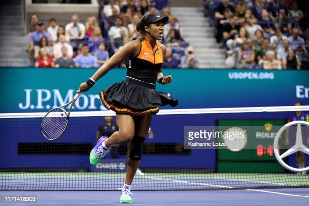 Naomi Osaka of Japan reacts during her Women's Singles third round match against Cori Gauff of the United States on day six of the 2019 US Open at...