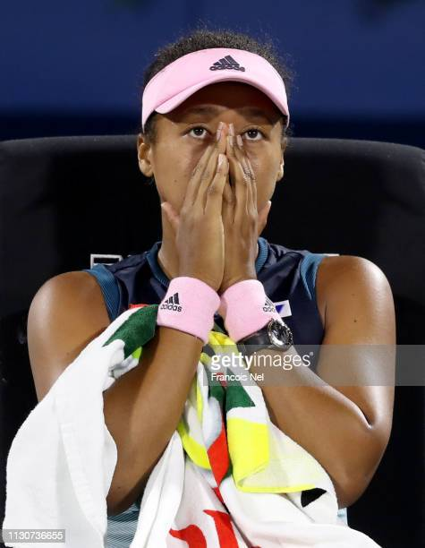 Naomi Osaka of Japan reacts in her singles match against Kristina Mladenovic of France during day three of the WTA Dubai Duty Free Tennis...
