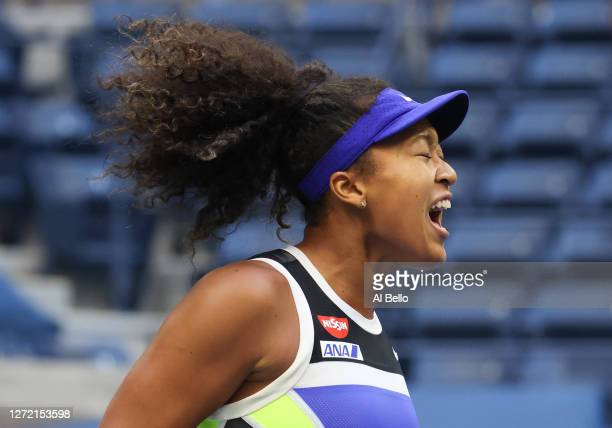 Naomi Osaka of Japan reacts in the third set during her Women's Singles final match against Victoria Azarenka of Belarus on Day Thirteen of the 2020...