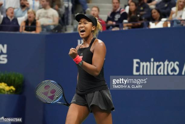 Naomi Osaka of Japan reacts on court against Serena Williams of the US during their Women's Singles Finals match at the 2018 US Open at the USTA...