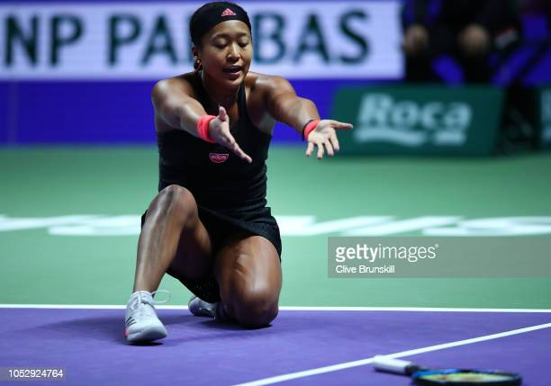 Naomi Osaka of Japan reacts to a missed shot in her women's singles match against Angelique Kerber of Germany during day 4 of the BNP Paribas WTA...
