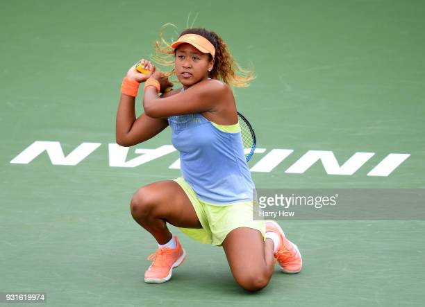 Naomi Osaka of Japan reacts to her backhand in her match against Maria Sakkari of Greece during the BNP Paribas Open at the Indian Wells Tennis...
