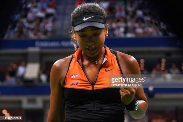 Naomi Osaka of Japan reacts to her point against Coco Gauff of the US in their Round Three Women's Singles tennis match during the 2019 US Open at...
