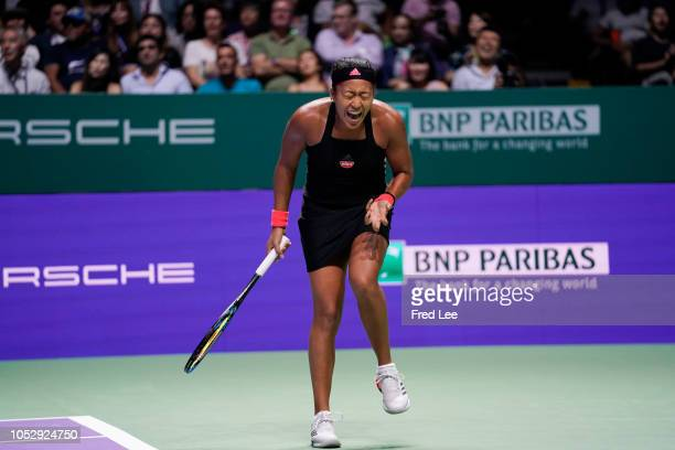 Naomi Osaka of Japan reacts to her shot in her women's singles match against Angelique Kerber of Germany during day 4 of the BNP Paribas WTA Finals...