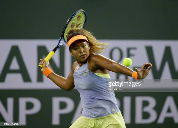 Naomi Osaka of Japan returns a forehand to Sachia Vickery during the BNP Paribas Open on March 11 2018 at the Indian Wells Tennis Garden in Indian...