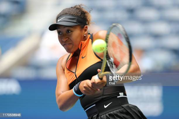 Naomi Osaka of Japan returns a shot against Anna Blinkova of Russia during their Women's Singles first round match on day two of the 2019 US Open at...