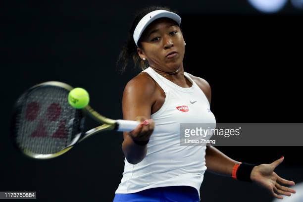 Naomi Osaka of Japan returns a shot against Caroline Wozniacki of Denmark during the Women's singles Semifinals of 2019 China Open at the China...