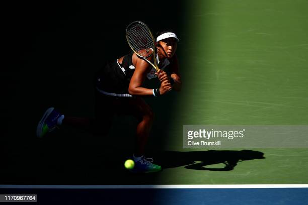 Naomi Osaka of Japan returns a shot during her Women's Singles second round match against Magda Linette of Poland on day four of the 2019 US Open at...